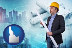 Idaho - building contractor holding blueprints - cityscape background