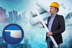 Oklahoma - building contractor holding blueprints - cityscape background